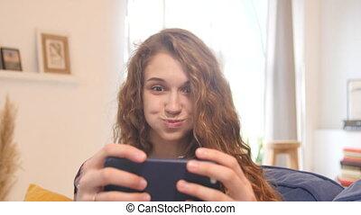 Beautiful young woman taking photo smiling