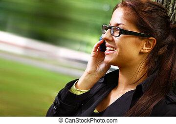Beautiful young woman telephone talking