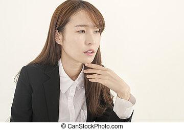 Beautiful young woman thinking