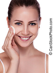 Beautiful Young Woman Touching Her Face. Fresh Healthy Skin. Isolated on White