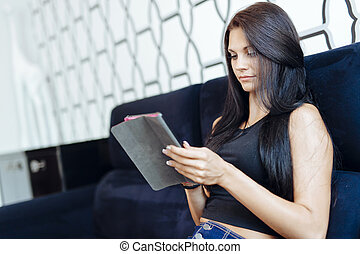 Beautiful young woman using a tablet