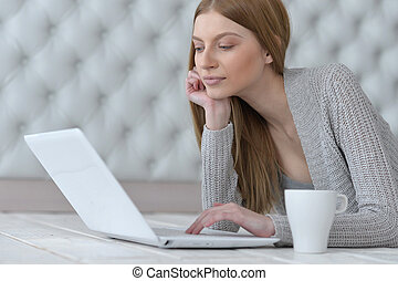 Beautiful young woman using computer