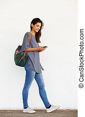Beautiful young woman using mobile phone