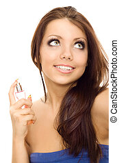 beautiful young woman using perfume isolated on white