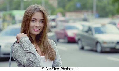beautiful young woman walking on the street - Half length...
