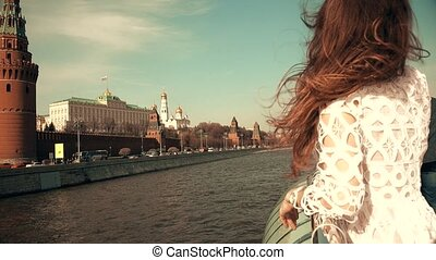 Beautiful young woman watching at Moscow Kremlin. Travel to Russia concept. 4K shot