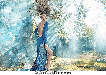 Beautiful young woman wearing a fabulous dress