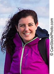 Beautiful young woman wearing a purple wind jacket
