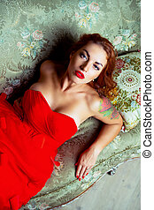 beautiful young woman  wearing a red dress
