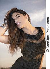 Beautiful young woman wearing black