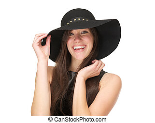 Beautiful young woman wearing black hat and laughing