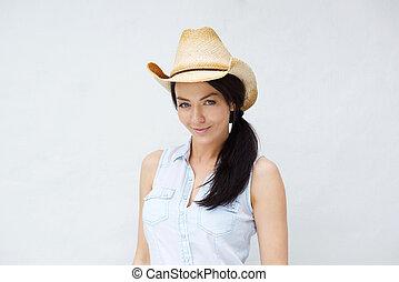 Beautiful young woman wearing cowboy hat