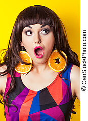 beautiful young woman wearing earrings made from orange ...
