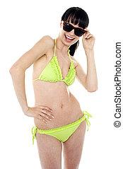 Beautiful young woman wearing green bikini