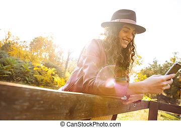 Beautiful young woman wearing hat
