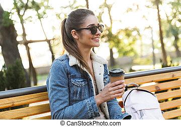 Beautiful young woman wearing jacket sitting