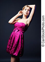 Beautiful young woman wearing pink dress