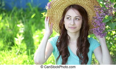 Beautiful young woman wearing straw