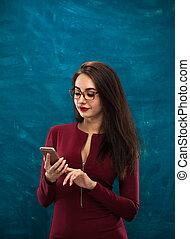 Beautiful young woman wearing stylish eyeglasses