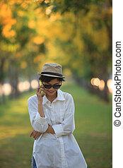 beautiful young woman wearing sun glassea nd straw hat...