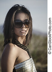 Beautiful young woman wearing sungl