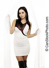 Beautiful young woman wearing white
