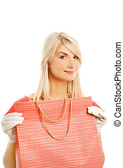 Beautiful young woman with a bag. Isolated on white background