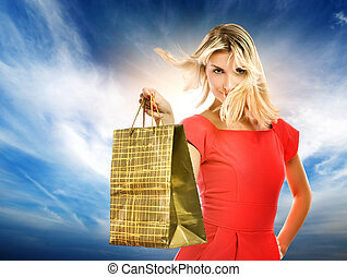 Beautiful young woman with a bag