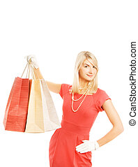 Beautiful young woman with a bags. Isolated on white background