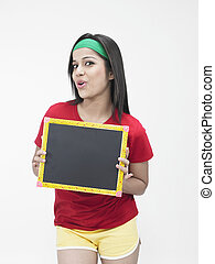 young woman with a black board