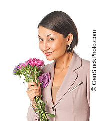 Beautiful young woman with a bouquet of flowers