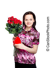 beautiful young woman with a bouquet of red roses