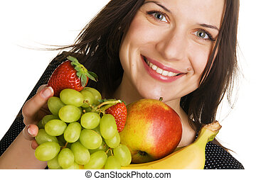 Beautiful young woman with a bunch of fruits