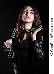Beautiful young woman with a chain