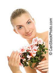 Beautiful young woman with a flower isolated on white background