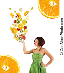 Beautiful young woman with a fruit salad