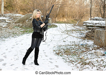 Beautiful young woman with a gun