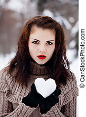 heart made of snow in her hands
