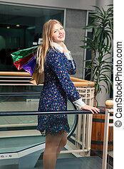beautiful young woman with a shopping bags in the mall