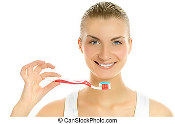 Beautiful young woman with a toothbrush isolated on white background