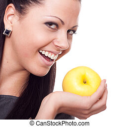 Beautiful young woman with apple over white background