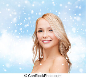 beautiful young woman with bare shoulders