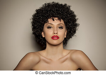 young woman with black curly wig - beautiful young woman...