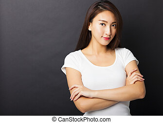 beautiful young woman with black ground