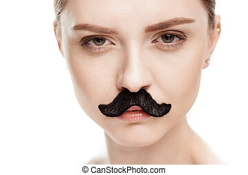 beautiful young woman with black mustaches looking at camera isolated on white.