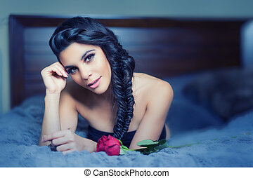 Beautiful young woman with braided