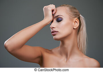 Beautiful young woman with bright make-up.