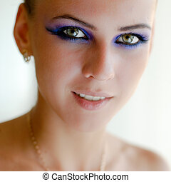 Beautiful young woman with bright makeup closeup portrait