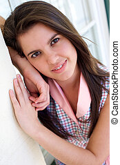 Beautiful young woman with brown hair smiling