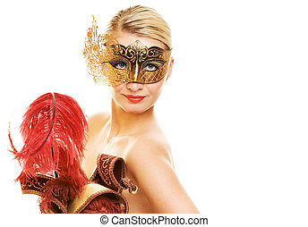 Beautiful young woman with carnival mask on her face